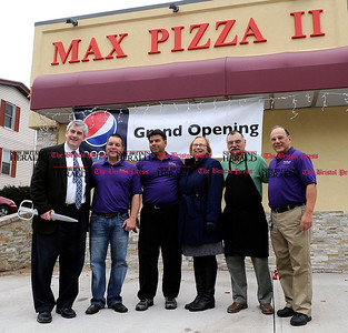 12/01/2012 Mike Orazzi | Staff New Britain Mayor Tim O'Brien cuts the ribbon to officially open Max Pizza II on Shuttle Meadow Ave in New Britain on Saturday morning.
