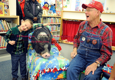 12/01/2012 Mike Orazzi | Staff Joshua Norton,6, while visiting with Paul Minor's pig Daisy II while at the Bristol Public Library on Saturday.