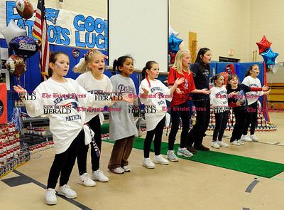 2/1/2012 Mike Orazzi | Staff Bristol Bulldog cheerleaders and South Side School students and faculty honor Terri Hernandez, mother of Super Bowl bound New England Patriot Aaron Hernandez, at the Bristol elementary school on Wednesday afternoon.
