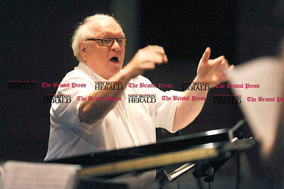 Ken Ferris directs the chorus during the 50th Anniversary Reunion Concert at Bristol Eastern High School on Saturday.