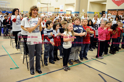 2/1/2012 Mike Orazzi | Staff South Side School students and faculty honor Terri Hernandez, mother of Super Bowl bound New England Patriot Aaron Hernandez, at the Bristol elementary school on Wednesday afternoon.