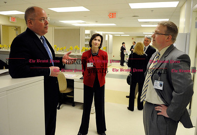 3/24/2011 Mike Orazzi | Staff Bristol Hospital President and Chief Executive Officer Kurt Barwis (left) talks with Vice President, Strategic Planning and Business Development Kathleen Buckley (center) and Director of Pharmacy Charlie Waters (right) inside the Bristol Hospital and Health Care Group's new state-of-the-art pharmacy during a reception on Thursday evening. The new pharmacy opens Saturday at 7 a.m.