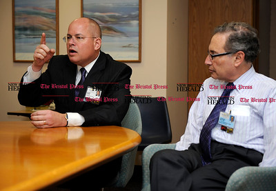 11/10/2011 Mike Orazzi | Staff Bristol Hospital President and CEO Kurt Barwis (left)talks about upcoming emergency room changes at the hospital with chief medical officer Leonard Banco.