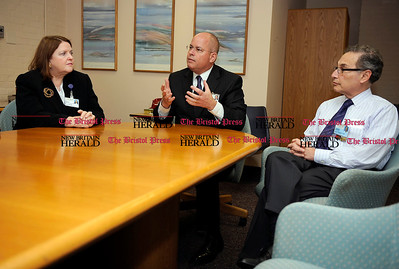 11/10/2011 Mike Orazzi | Staff Bristol Hospital President and CEO Kurt Barwis (center) talks about upcoming emergency room changes at the hospital with chief nursing officer Sheila Kempf and chief medical officer Leonard Banco.