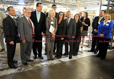 6/01/2012 Mike Orazzi | Staff Gov. Dannel Malloy poses for a group photo while on tour of Peter Paul Electronics in  New Britain on Friday morning.