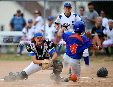 6/1/2012 Mike Orazzi | Staff Southington's Rachel Harvey (12) puts the tag on Danbury's Erica Carboni (4) during the Class LL Quarterfinal with Danbury at SHS on Friday.