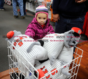 3/3/2012 Mike Orazzi | Staff Jailyn Rosado,3, looks at Rock Cats pillows during the fan fest  on Saturday morning at Rock Cats stadium.