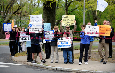5/1/2012 Mike Orazzi | Staff Bristol teachers hold signs along Memorial Blvd. while waiting for Governor Dannel P. Malloy and Lt. Governor Nancy Wyman to arrive for a town hall meeting to discuss the governor's proposed education reforms on Tuesday night in Bristol at the Memorial Blvd. School.