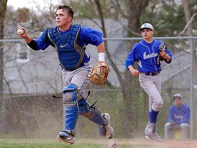 Eastern catcher Connor Fitzsimons runs back a Middletown baserunner on Wednesday.  Johnny Burnham | Staff