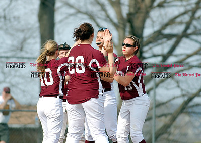 The Rams celebrate an Emily Cintorino strikeout during their 8-0 win over East Catholic on Monday.  Johnny Burnham | Staff