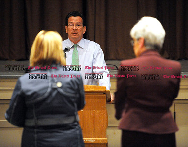 5/1/2012 Mike Orazzi | Staff Governor Dannel P. Malloy (center) and Lt. Governor Nancy Wyman (right) during a town hall meeting to discuss proposed education reforms on Tuesday night in Bristol at the Memorial Blvd. School.