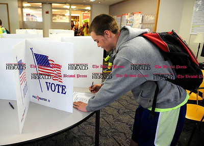 11/1/2012 Mike Orazzi | Staff Bristol Central High School student Anthony Amenta votes  during a mock election on Thursday at Central.