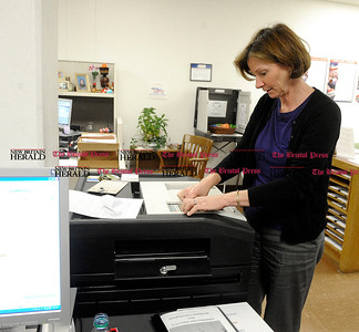 10/31/2012 Mike Orazzi | Staff Sharon Krawiecki Republican Registrar of Voters replaces the paper on a sample voting machine at Bristol City Hall on Wednesday afternoon.