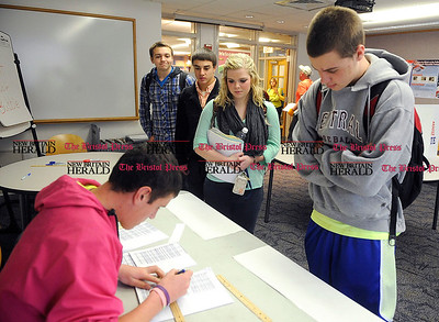 11/1/2012 Mike Orazzi | Staff Bristol Central High School David Behmke checks in fellow student Anthony Amenta as he checks in while voting in a mock election at Central on Thursday.