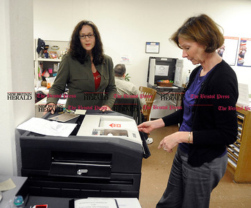 10/31/2012 Mike Orazzi | Staff Democratic Registrar of voters Mary Rydingsward and Sharon Krawiecki Republican Registrar of Voters check a sample vote counter at Bristol City Hall on Wednesday afternoon.