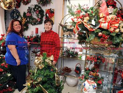 11/1/2012 Mike Orazzi | Staff Diane Pelletier and her mom Donna Lavoie at Donna's Florist in Forestville.