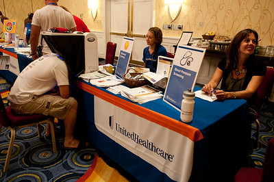 Ride2Recovery participants attend a health fair presented by UnitedHealthcare during registration for the 2012 Ride2Recovery Minuteman Challenge .