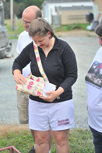 Moe Garmon shows off her hand made bag given to her in honor of her hard work as a voulenteer during the recovery