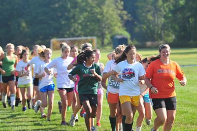 The team takes a warm-up jog