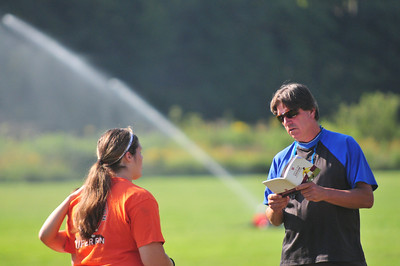 Lizzy Miller, Captain (left) recieves her instrtuctions from coach Greg Labella