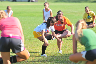 Captains Annie Arthur (center Left) and Lizzy Miller (center right) lead warm up stretches