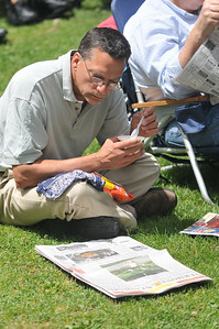 Chris Miller reads The Vermont Standard while he listens
