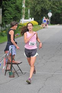 Carmen Bango Crosses the finish
