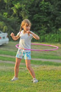 Grace Saibetta hoola-hoops near the picnic area