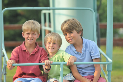 Boden Gamill (left), Bower Gamill (center), Griffin Deane (right) pose while playing on the chairlift