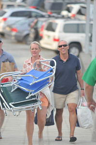 Missy griffiths (left), Chris Griffiths (right) walk to the picnic area with lawn chairs 2