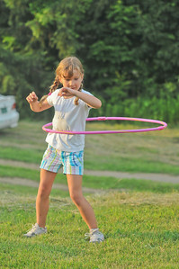Grace Saibetta hoola-hoops near the picnic area  2