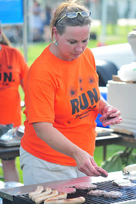 Joni Kennedy flips burgers to benefit the Spectrum Teen Center