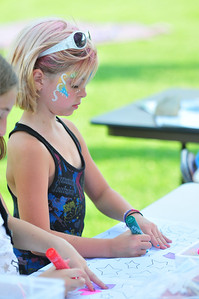 Katrina feddersen draws at the art table