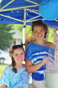 Ana Haimovitz (left) Delaney Little(right) sell cotton candy to benefit their senior class