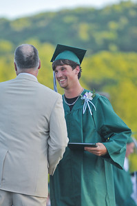 Jon DeDell receives his diploma from Dwight Doton