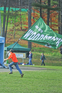 Justice Bassette proudly carries the woodstock flag