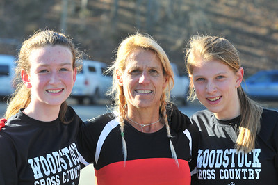 Claire Spangler (left0 and Lindsay Stuntz (right) stand with Woodstock Cross Country Coach Tracy Rose (center)