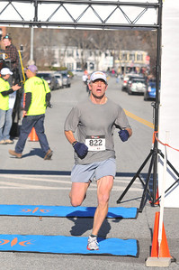 Chris Lang crosses the finish in 3rd overall