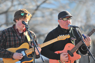"""Jack Snyder (left), John Snyder (right) play with the band """"automatic rooster"""""""