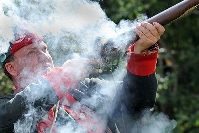 IMG_5498 Kings Rangers member Phil Greenough touches off brown bess musket