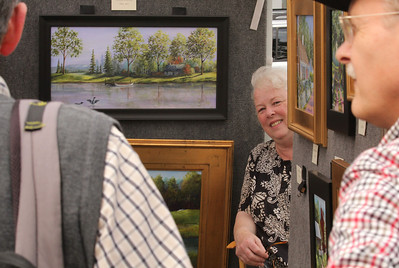 Eileen Belanger of New Boston, nh, shows off her paintings done in acrylic