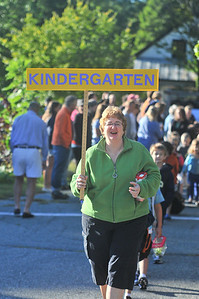 Betsy Stockwell (teacher) leads her kindergarden class into the building