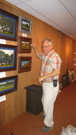 George Boutwell handing his art