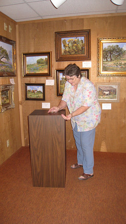 Ann Strand (Gallery Chair for many years) getting everything in order
