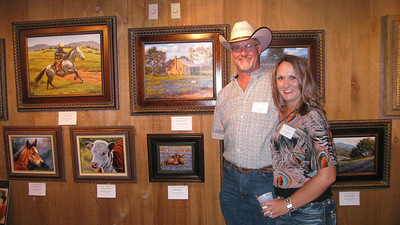 Paul Cameron & Gina Smith with his paintings