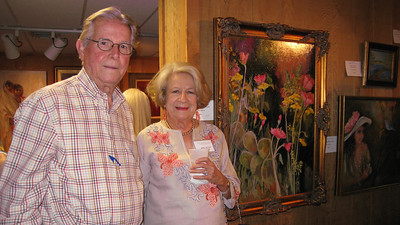 "Bill & Judy Jackson from Midland bought Maxie's ""Wild Flowers"""