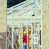 wood frame construction job seen trhough window opening