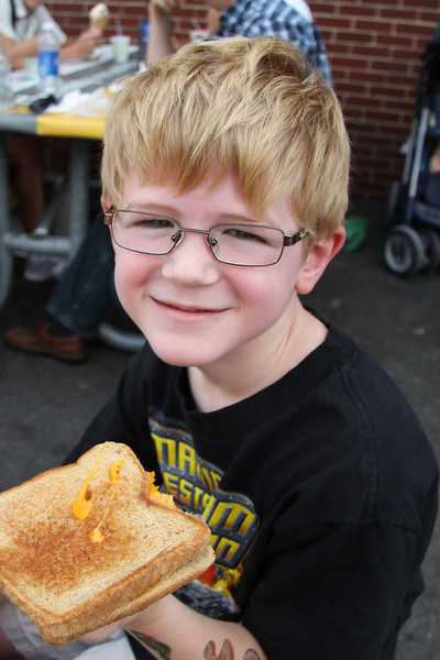 John showing off his grilled cheese @ 2012 State Fair