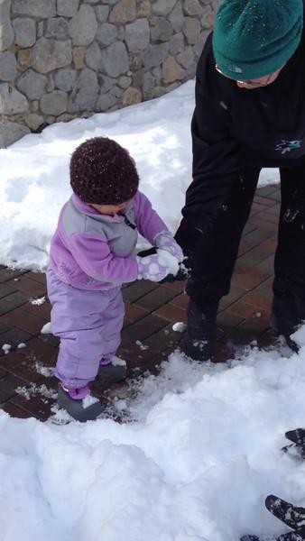 Throwing snowballs with Nana.