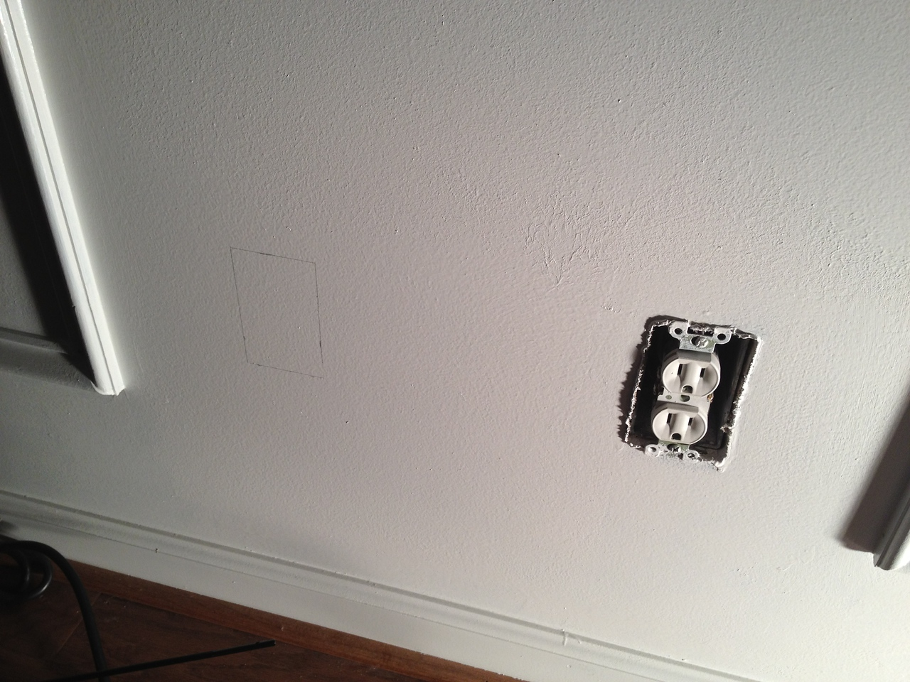 Marking the location for the junction box in the office